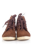 Pair of old Brown working boots with shadows Royalty Free Stock Photo