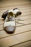 Pair of old dance shoes. On wooden floor Royalty Free Stock Photo