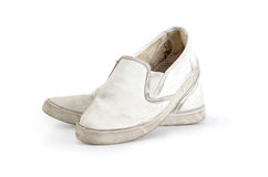A pair of old dirty sneakers Clipping path included. royalty free stock image