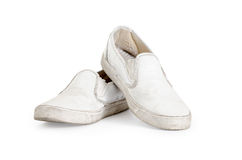 A pair of old dirty sneakers Clipping path included. Royalty Free Stock Photos