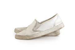 A pair of old dirty sneakers Clipping path included. stock image