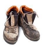 Pair of old dirty trekking boots Stock Photos