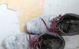 Pair of old dirty work boots in building site Royalty Free Stock Photography
