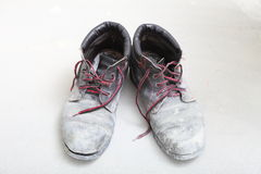 Pair of old dirty work boots in building site Stock Photography