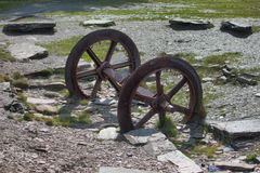 A pair of old disused metal mine train wheels Royalty Free Stock Images