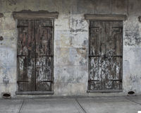 Pair of Old Doors. A pair of doors from an abandoned business in the French Quarter of New Orleans in Louisiana Royalty Free Stock Image