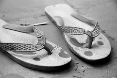 Old Flip-Flops. A pair of old flip-flops Royalty Free Stock Photos