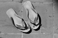 Old Flip-Flops. A pair of old flip-flops Royalty Free Stock Photography