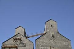 Pair of old grain elevators Stock Photography