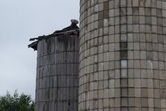 Pair of old grain silos. A pair of old grain silos stock images