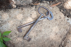 Pair of old keys on rocky surface Royalty Free Stock Photo