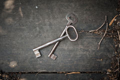 Pair of old keys on wooden surface Stock Image