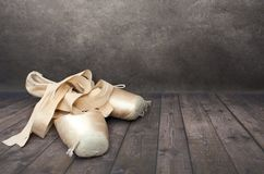 Pair of old point shoes dark background royalty free stock photo