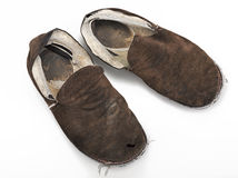 A pair of old, ratty house slippers Stock Photos