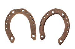 Pair of old rusty horseshoes isolated Stock Photos