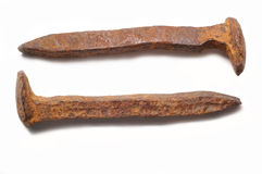 Pair of old rusty railroad spi. Old rusty railroad spikes isolated on a white background Stock Images