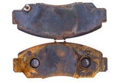 Pair of old rusty worn brake pads Royalty Free Stock Image