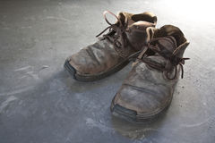 Pair of old shoes. A pair of old brown shoes on the floor stock photography