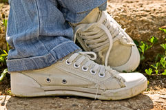 Pair of old sneakers. On the street Royalty Free Stock Photography