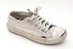 A pair of old sport shoes. It is a pair of old shoes, originally in white color Royalty Free Stock Photos