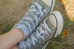 Pair of old trainers. Closeup in the grass royalty free stock photography