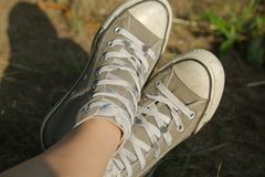 Pair of old trainers. Closeup in the grass Stock Images