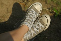 Pair of old trainers. Closeup in the grass Royalty Free Stock Image