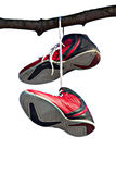 Pair of old and used training shoes hanging on a t Royalty Free Stock Photography