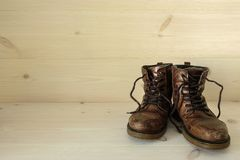 A pair of old well used brown leather boots Royalty Free Stock Image