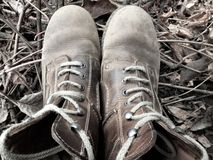 Pair of old well worn outdoor boots. Pair of old well worn outdoor brown boots Stock Images