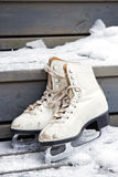 Pair of old white skates on snowy stairs Royalty Free Stock Photos