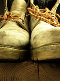 Pair of old, worn heavy boots. Royalty Free Stock Photo