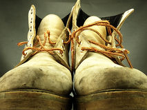Pair of old, worn heavy boots. Royalty Free Stock Images