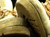 Pair of old, worn heavy boots. Stock Images