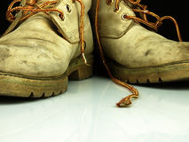 Pair of old, worn heavy boots. Royalty Free Stock Photography