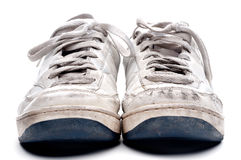 A pair of old worn sports shoes Stock Image
