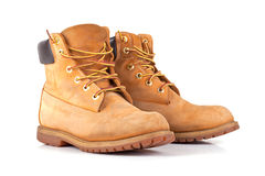 Pair of old yellow working boots. Royalty Free Stock Photo