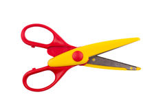 Pair of open red scissors. Top view of a pair of red colored plastic open scissors isolated on white background stock photo