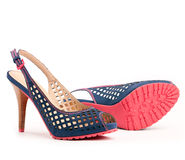 Pair of open-toe female shoes Royalty Free Stock Images