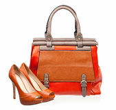 Pair of open-toe female shoes and handbag. Over white background stock photo