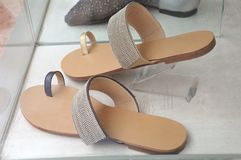 A pair of open toe sandals with big toe loop strap. A photo taken on a pair of light brown open toe sandals with big toe loop straps. The straps are laid with Stock Photos