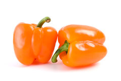 Pair of orange bell peppers. Isolated on the white background Royalty Free Stock Photos