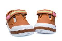 Pair of orange child   sneakers Stock Image