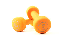 Pair of orange dumbbells Stock Photos