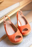 Pair of orange lady shoes. Stock Photo