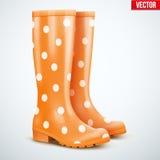 Pair of orange rain boots Stock Photography