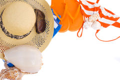 Pair of orange sandals, hat and  seashells  frame Stock Photography
