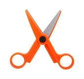 Pair of orange scissors on white. Background Royalty Free Stock Image