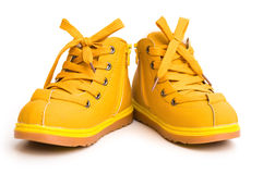 Pair of orange shoes. For kid on white background stock photo