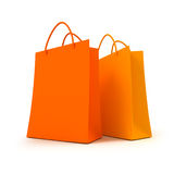 Pair of orange shopping bags. 3D rendering of two orange shopping bags against a white background Stock Photos